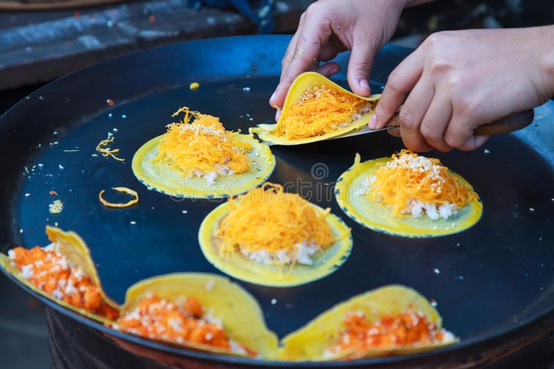 Delicious Thai street dessert, Kanom Buang, Thai Crispy Pancake or Thai Crepe, with varieties of fillings such as sweet white. Custard cream and golden sweet royalty free stock photography