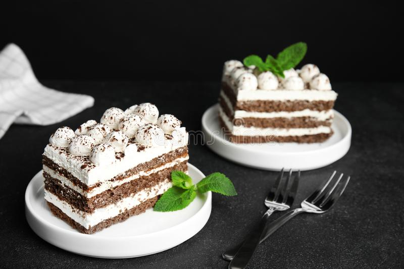 Delicious tiramisu cakes with mint. On table royalty free stock photo