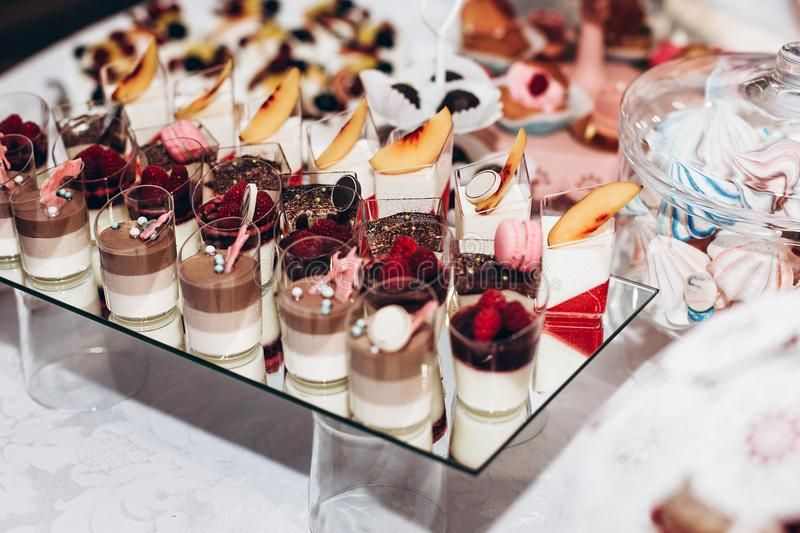 delicious tiramisu. candy bar at luxury wedding reception. exclusive expensive catering. table with modern desserts, cupcakes, sw stock photo