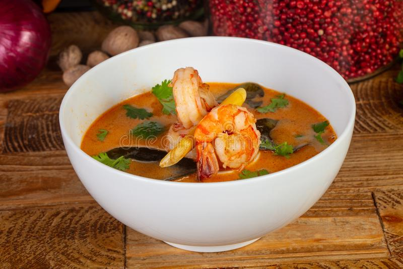 Delicious Tom Yum. Soup with herbs royalty free stock photography