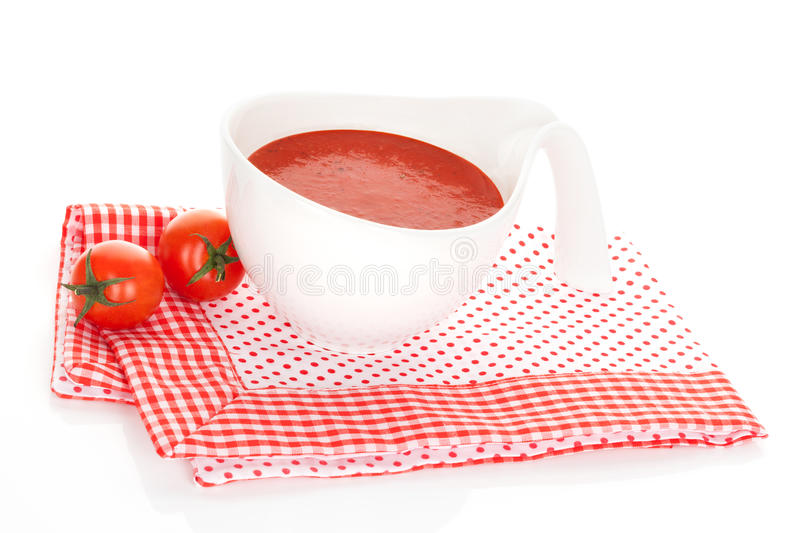 Delicious tomato soup. Delicious tomato soup background in red and white. Culinary healthy soup eating concept royalty free stock image