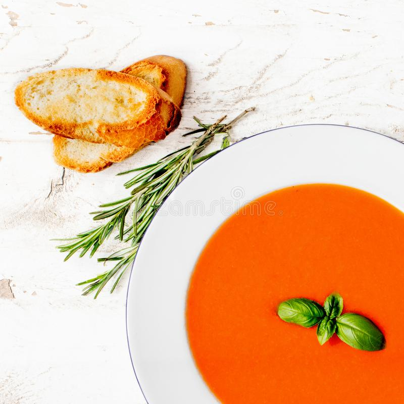 Delicious Tomato soup on a white rustic table. Flat lay. Copysp. Ace stock photo
