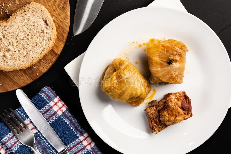 Delicious traditional Sarma with minced meat and sauerkraut. Roll, stuffed, food, vegetable, lunch, russian, plate, eating, cooked, cuisine, meal, cabbage royalty free stock photos