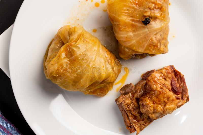 Delicious traditional Sarma with minced meat and sauerkraut. Roll, stuffed, food, vegetable, lunch, russian, plate, eating, cooked, cuisine, meal, cabbage stock photo