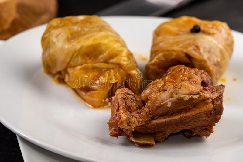Delicious traditional Sarma with minced meat and sauerkraut. Roll, stuffed, food, vegetable, lunch, russian, plate, eating, cooked, cuisine, meal, cabbage royalty free stock photo