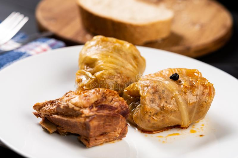 Delicious traditional Sarma with minced meat and sauerkraut. Roll, stuffed, food, vegetable, lunch, russian, plate, eating, cooked, cuisine, meal, cabbage royalty free stock images