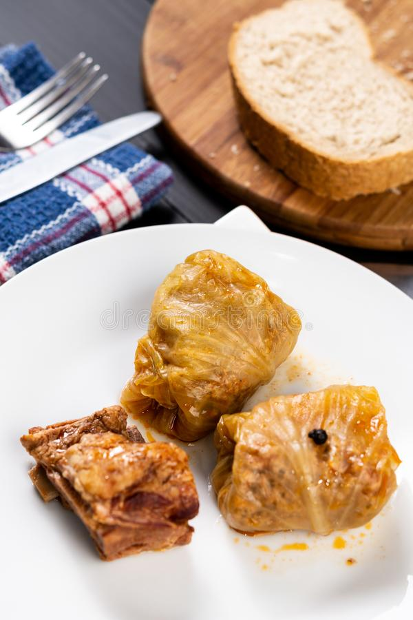 Delicious traditional Sarma with minced meat and sauerkraut. Roll, stuffed, food, vegetable, lunch, russian, plate, eating, cooked, cuisine, meal, cabbage stock image