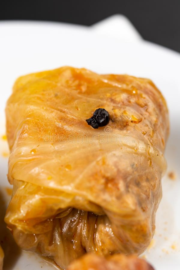 Delicious traditional Sarma with minced meat and sauerkraut. Roll, stuffed, food, vegetable, lunch, russian, plate, eating, cooked, cuisine, meal, cabbage stock photography