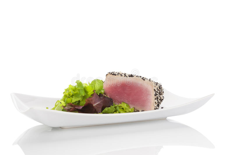 Delicious tuna steak with salad. royalty free stock images