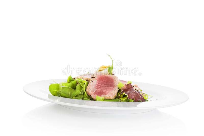 Delicious tuna steak with salad. stock photography