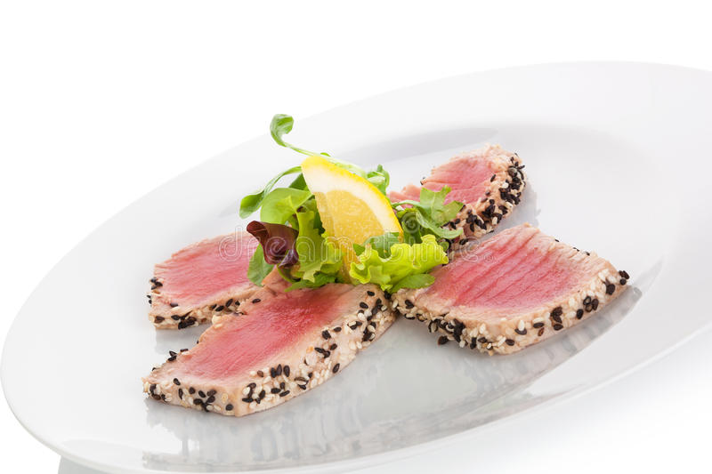 Delicious tuna steak with salad. royalty free stock photos