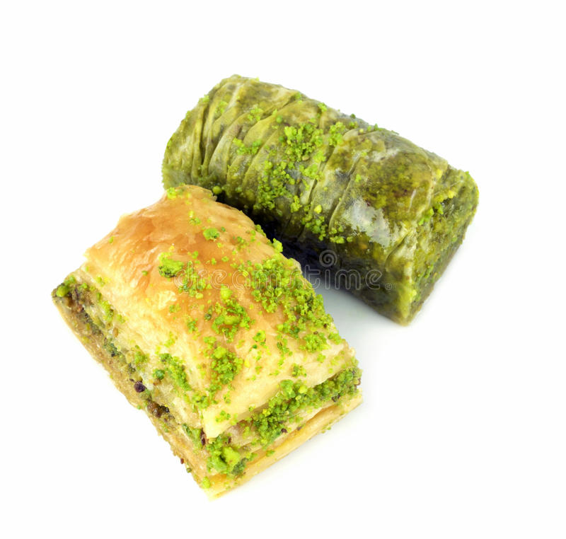 Delicious Turkish baklava and sarma with green pistachio nuts. Delicious Turkish baklava and sarma with green pistachio nuts, isolated on white background royalty free stock photography