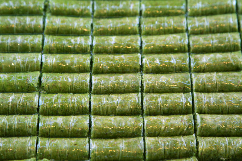 Delicious Turkish sweet, wrapped green pistachio nuts ( Sarma ). As background royalty free stock photos