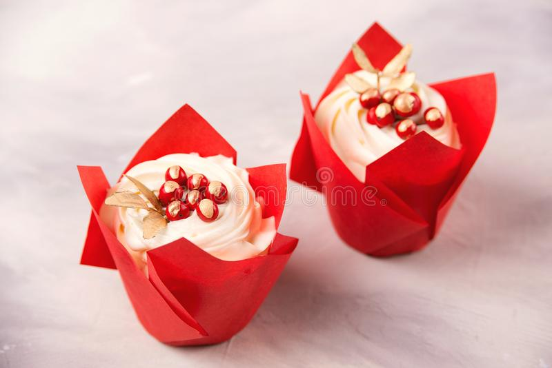 Delicious two cupcakes in red paper decorated with berries. Valentine day celebration royalty free stock image