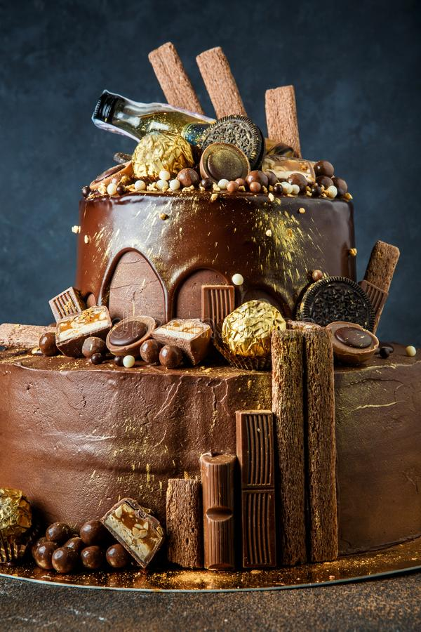 Delicious two layers rich decorated chocolate cake stock photos