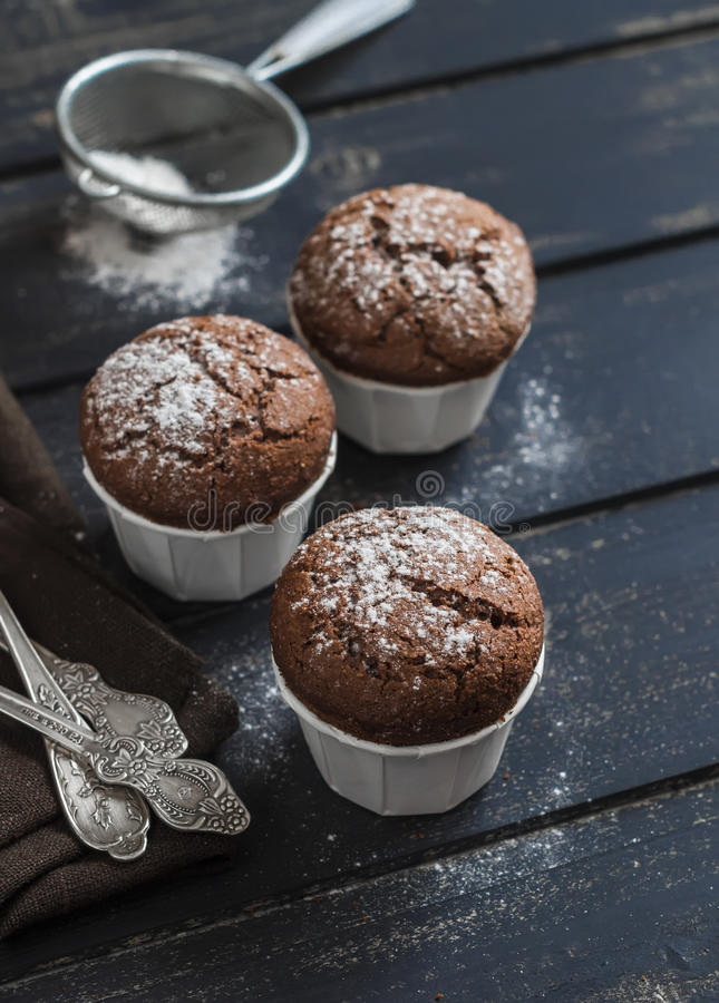 Delicious vegan chocolate muffins with icing sugar royalty free stock photography