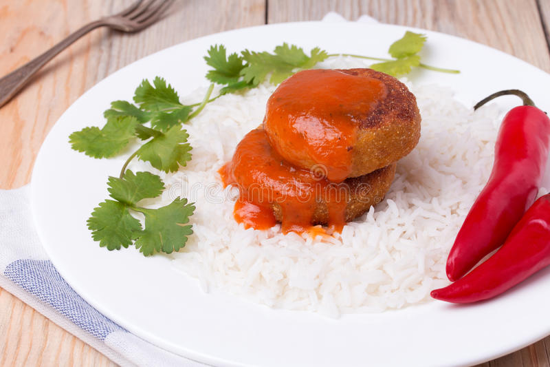 Delicious vegetable cutlets with rice royalty free stock images