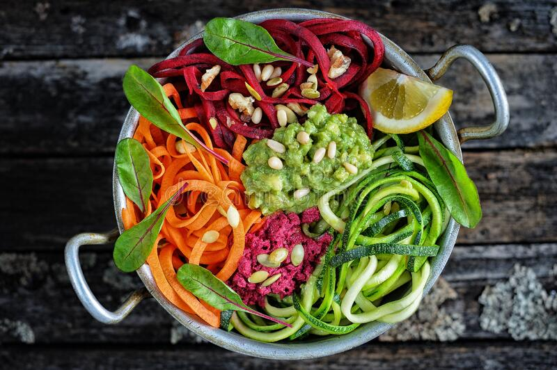 Delicious vegetable noodles with guacamole royalty free stock images