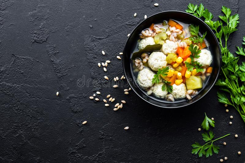 Delicious vegetable soup with chicken meatballs and pearl barley royalty free stock images