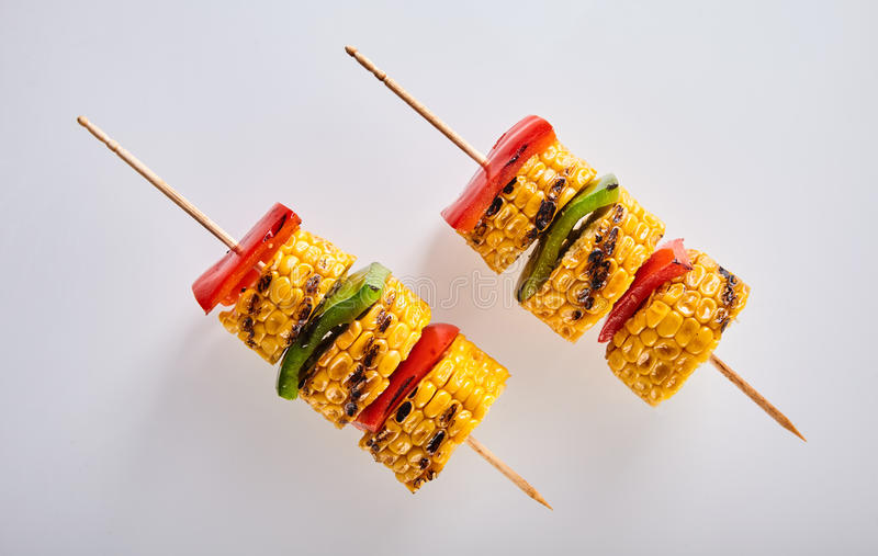 Delicious veggie skewers with corn and peppers. Delicious veggie skewers with corn and colorful red ad green bell peppers or capsicum for a healthy vegetarian stock photography