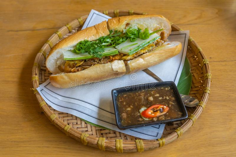 Delicious Vietnamese banh mi on traditional rattan tray in restaurant royalty free stock photography