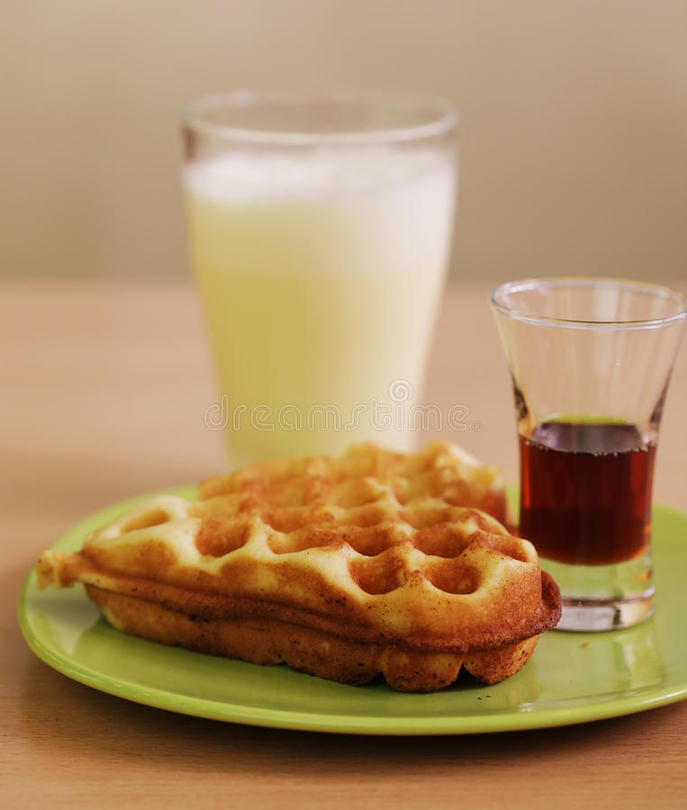Delicious waffle with milk. Delicious belgian waffle with milk stock image