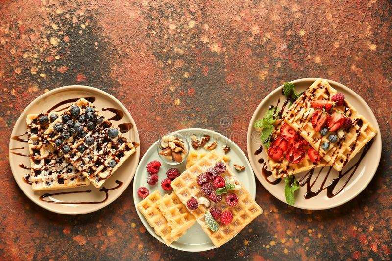 Delicious waffles with berries on plates, top view royalty free stock image