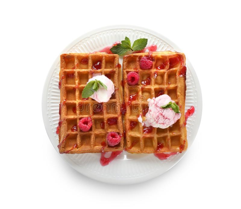 Delicious waffles with berry jam and ice cream on white background stock photos