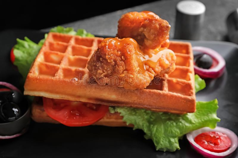Delicious waffles with chicken and vegetables on plate, closeup royalty free stock photo