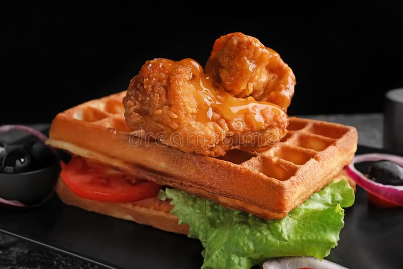 Delicious waffles with chicken and vegetables on plate, closeup stock images