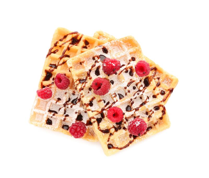 Delicious waffles with chocolate syrup and raspberries on white background stock images