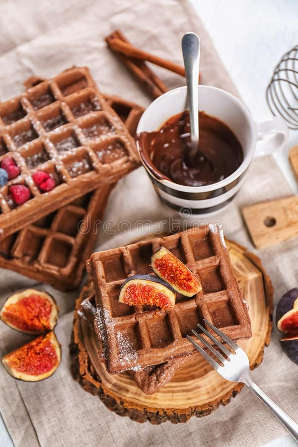Delicious waffles with fig slices on wooden board stock image