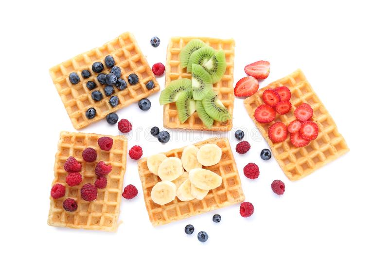 Delicious waffles with fruits and berries on white background royalty free stock images