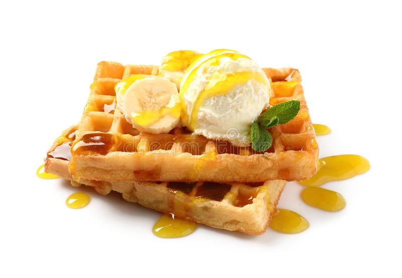 Delicious waffles with ice cream, banana and syrup. On white background stock photography