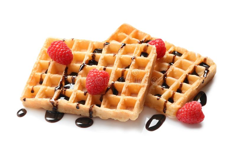 Delicious waffles with raspberries and chocolate syrup stock image