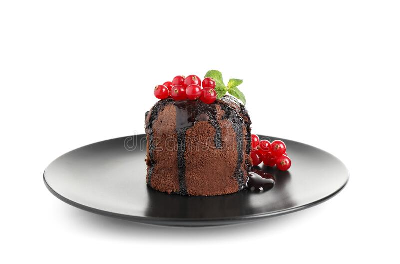 Delicious warm chocolate lava cake with mint and berries isolated. On white royalty free stock photos