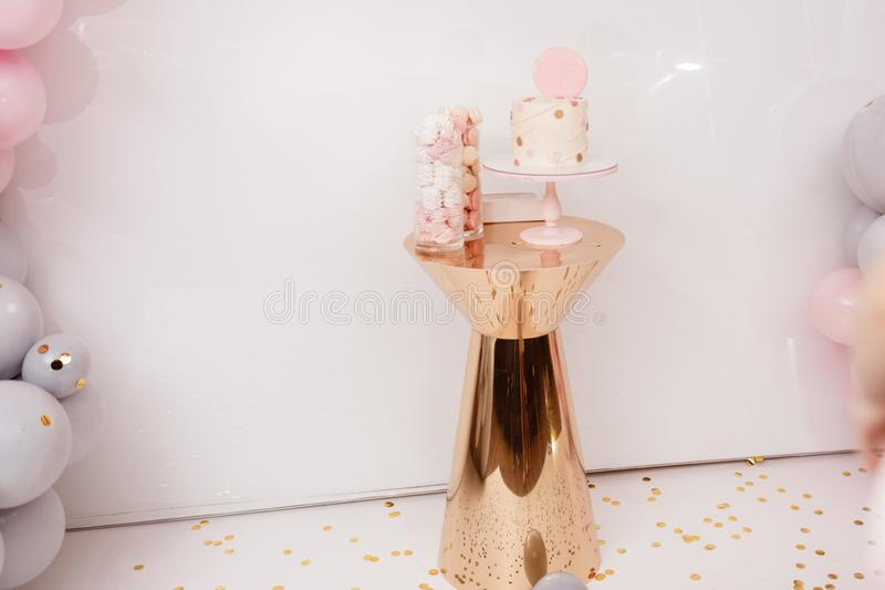 Delicious wedding reception. Birthday Cake on a background balloons party decor. Copy space. Candy bar royalty free stock images