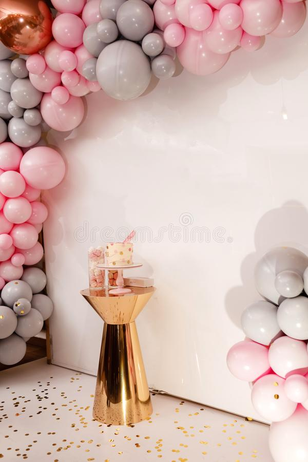 Delicious wedding reception. Birthday Cake on a background balloons party decor. Copy space. Candy bar stock image