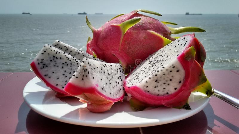 White dragonfruit at the ocean stock images