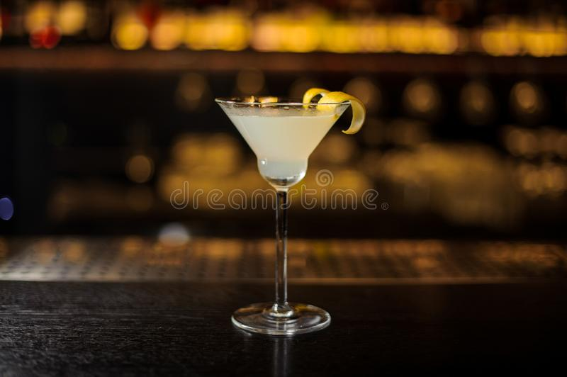 Delicious White Lady cocktail decorated with orange zest royalty free stock photos