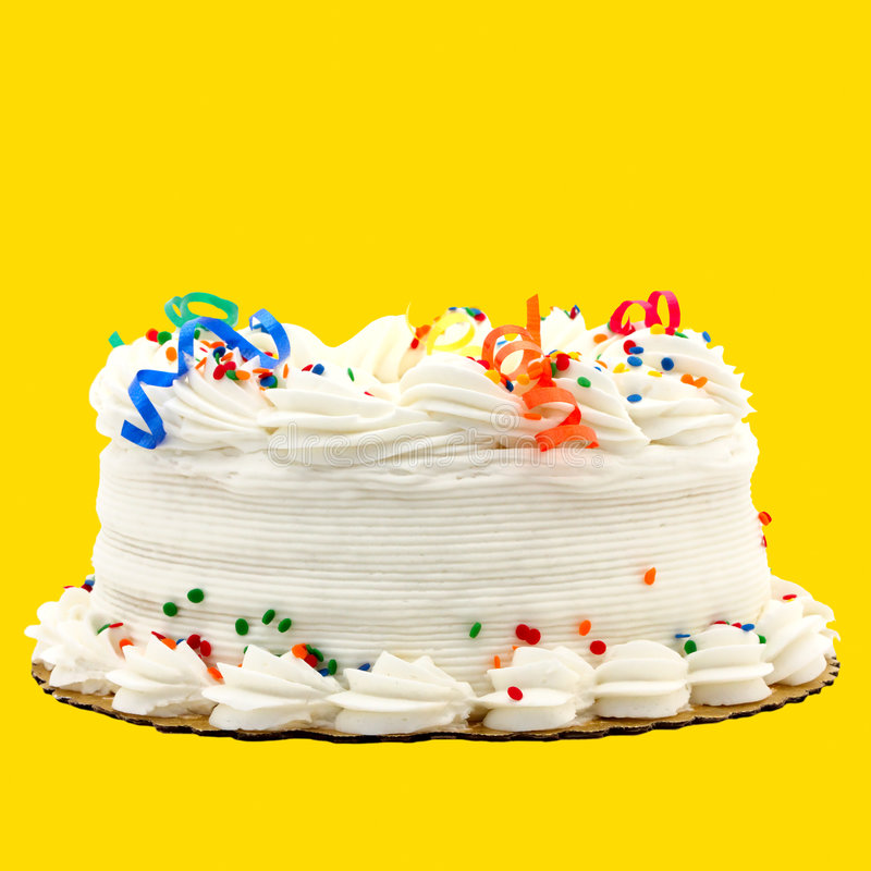 Delicious White Vanilla Birthday Cake Isolated On. Delicious White Vanilla Birthday Cake With Red, Blue, Green, Yellow and Orange Decorations ~ Isolated On royalty free stock photo