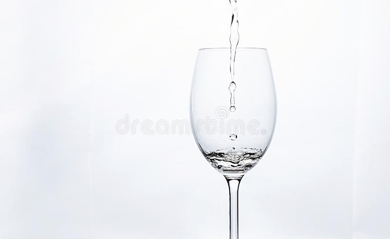 Delicious white wine falling royalty free stock images