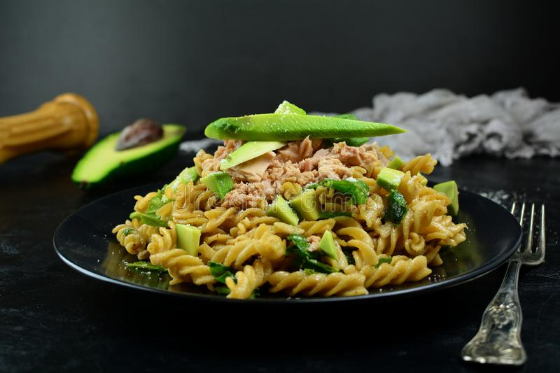 Delicious Whole Wheat Fusilli Pasta with Tuna, Olive Oil, and Avocado royalty free stock photography