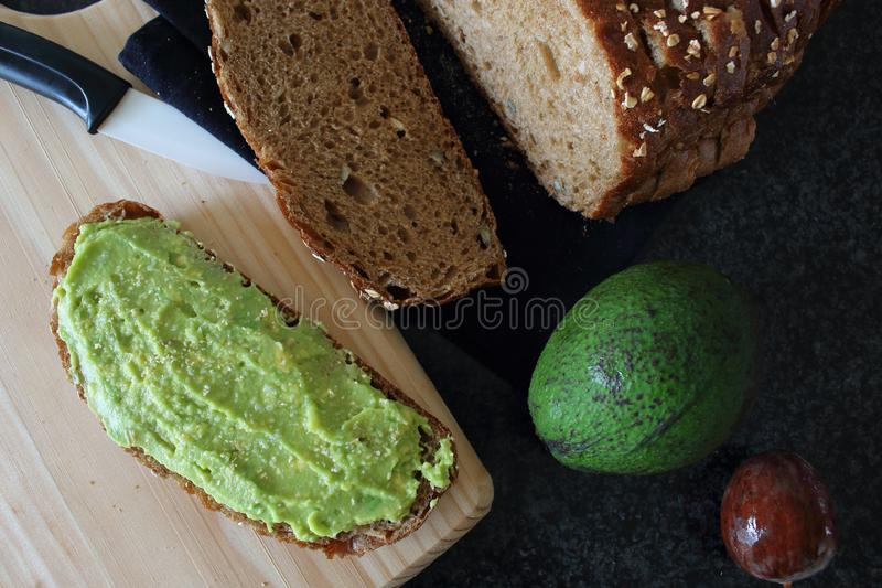 Delicious wholewheat toast with guacamole. Mexican and vegan cuisine. royalty free stock photo