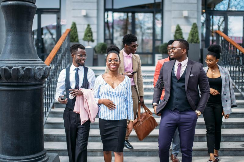 The deligation of african people are checking new constucted buildings. Important people stock photo