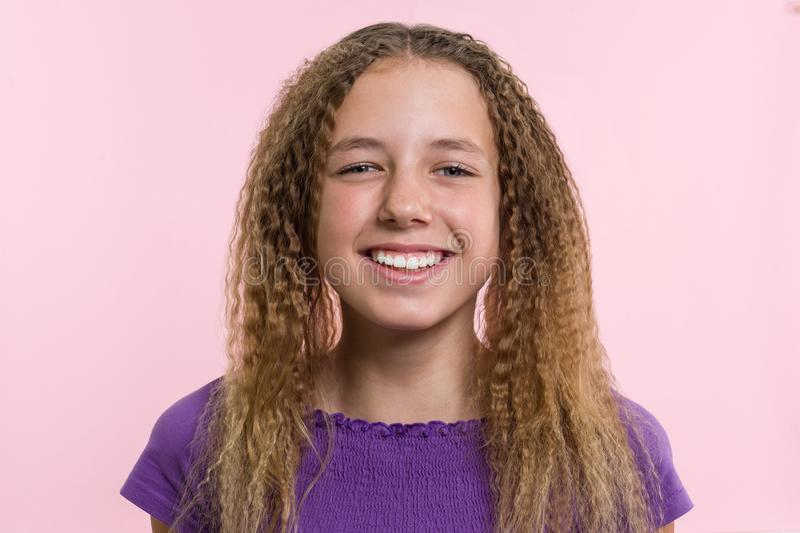 Delight, happiness, joy, victory, success and luck. Teen girl on a pink background. Facial expressions and people emotions concept royalty free stock photography