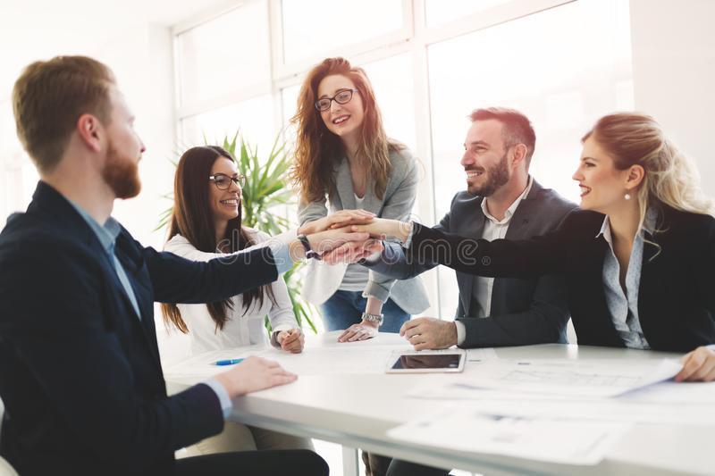 Delighted business people celebrating successful year stock image
