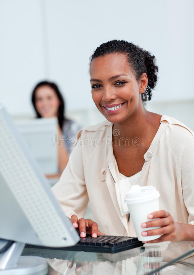 Download Delighted Businesswoman Holding A Drinking Cup Stock Photo - Image: 13154382