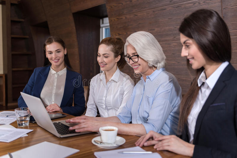 Delighted colleagues working together in office stock photo