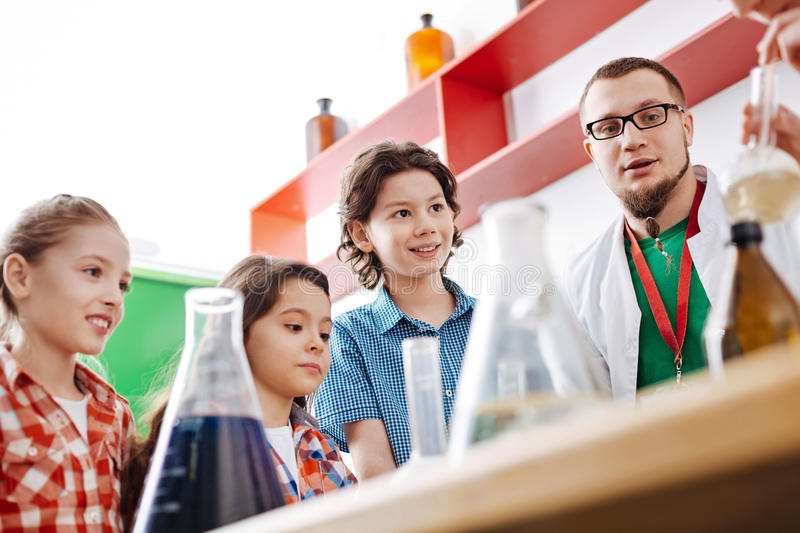 Delighted curious kids observing an experiment royalty free stock photography